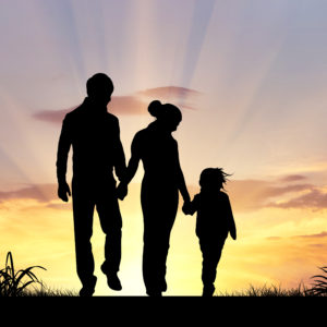 Silhouette of 2 parents and 1 child